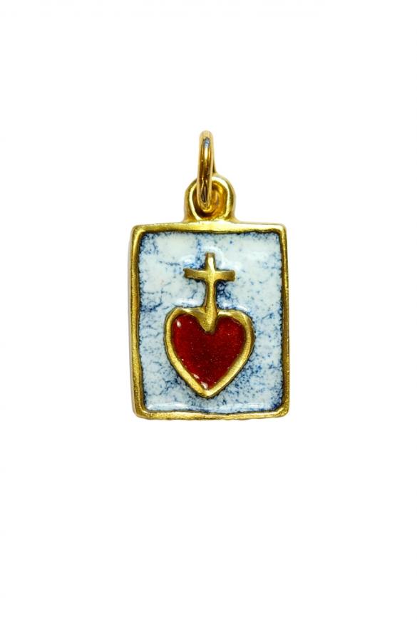 Médaille rectangulaire formant comme un petit scapulaire du Sacré Cœur. Fond émaillé en blanc.
